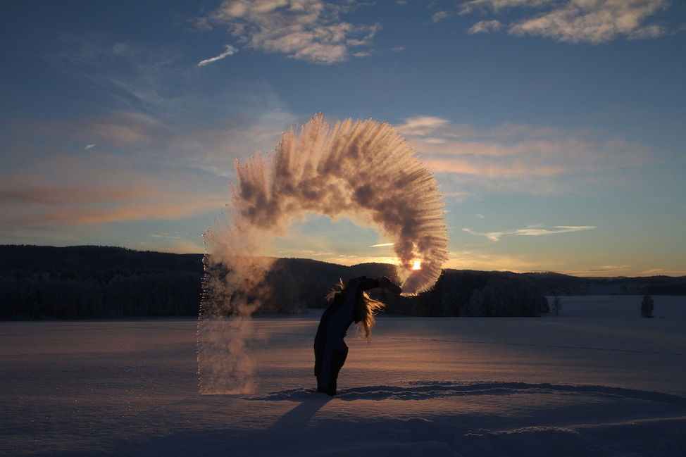 boiling water freezing weather snow winter throw sunset